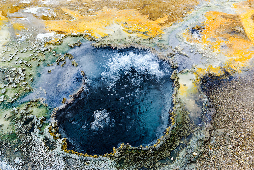 Bubbling water in geyser pool